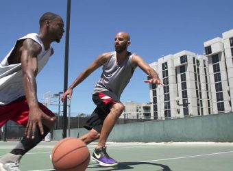 two people playing basketball